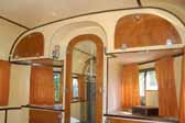 Photo shows interior cabinetry in a 1937 vintage Vagabond trailer