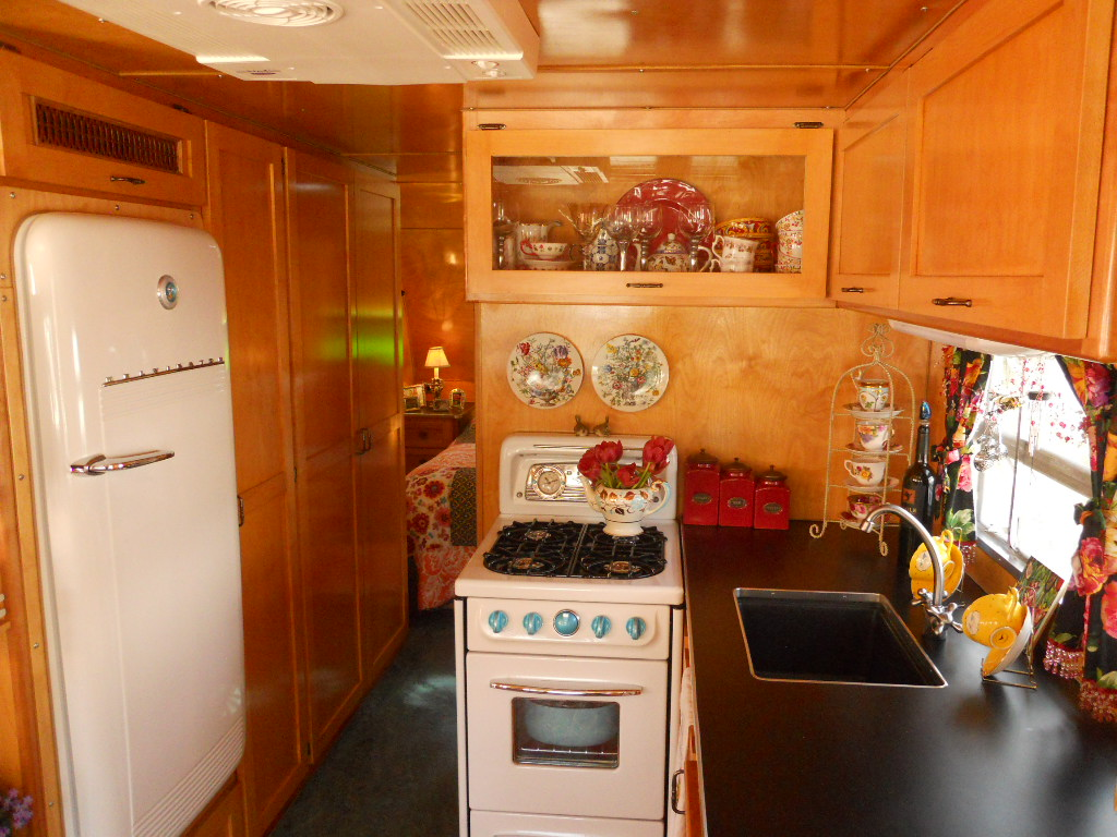 Restored Fridge Gas Stove And Kitchen Cabinets In 1938 Kozy Coach Trailer