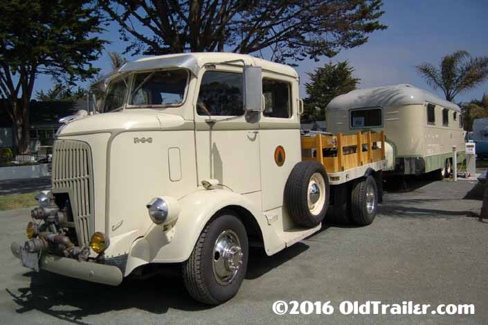 This vintage towing rig is a 1938 REO COE Stakebed Truck pulling a 1950 Westcraft Coronado Vintage Trailer