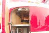 This is a close-up shot of the open access door and mecvhanicals closet in a 1941 GM Futurliner bus