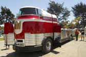 Picture of very rare restored 1941 GM Futurliner bus, showing open driver's door