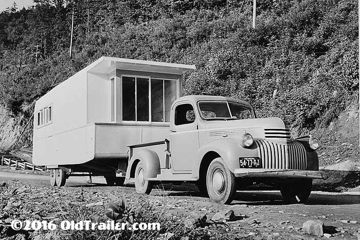 This vintage towing rig is a vintage chevy pickup truck pulling a 1941 manufactured trailer