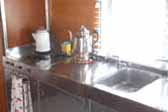Close-up photo of stainless steel sink and kitchen counter top - 1947 Aero Flite Trailer