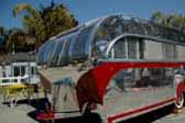 Restored Aero Flite vintage trailer has beautiful polished aluminum siding accented by painted red spear designs