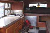 1947 Dodge Fishing Car camper has very efficient yet cozy interior cabinets and furnishings