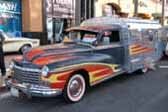 Great retro-flames paint job on this rare 1947 Dodge Fishing Car camper