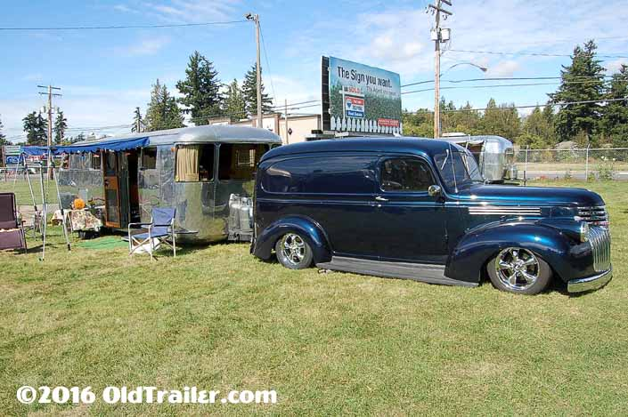 This vintage towing rig is a vintage chevy panel truck pulling a 1947 spartan-manor vintage trailer