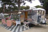 Photo of Large 1947 Spartan Manor Travel Trailer, Side Awning and Party Decorations