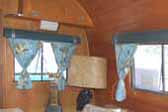 Photo shows souvenir pillows in 1947 Traveling Salesman Prototype trailer