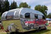Front view of a nicely restored 1948 Aero Flite travel trailer