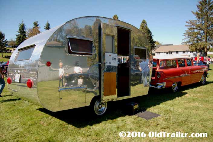 This vintage towing rig is a 1955 chevy station wagon pulling a 1948 boles aero vintage trailer