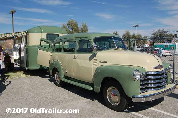 This vintage towing rig is a 1952 Chevy Suburban pulling a 1948 Palace Royal Vintage Trailer