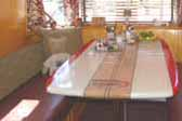 Photo of cool custom surfboard dining table in 1948 Spartan Manor Trailer