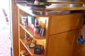 Photo of cool curved shelf curio cabinet in 1948 Spartan Manor Trailer
