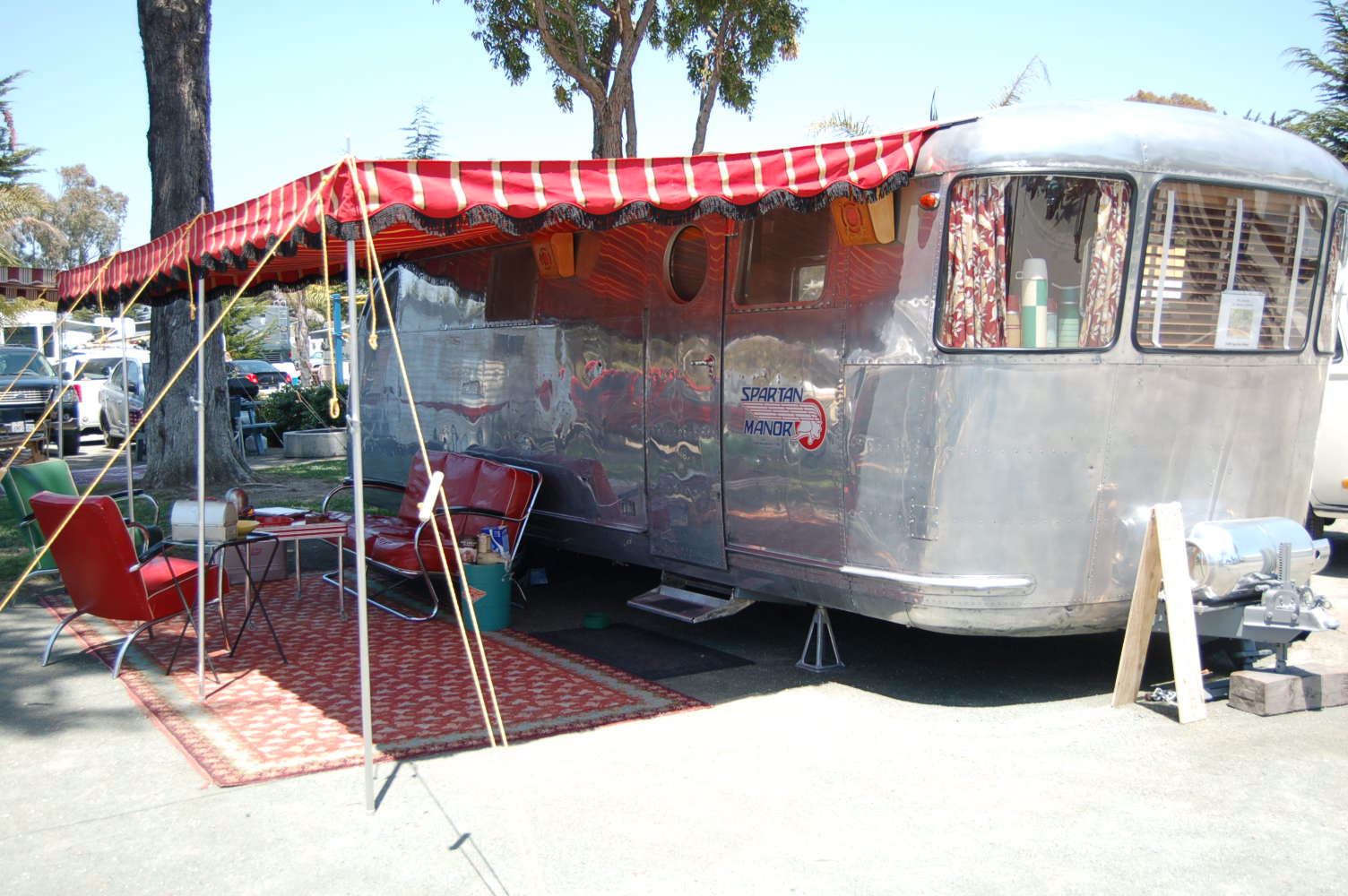 Picture of vintage 1948 spartan manor trailer showing classic wrap around windows