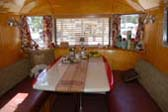 Slick and Stylish Dining Area in Classic 1948 Spartan Manor Trailer