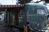Photo of a beautiful vintage 1948 Vagabond trailer with a striped side awning