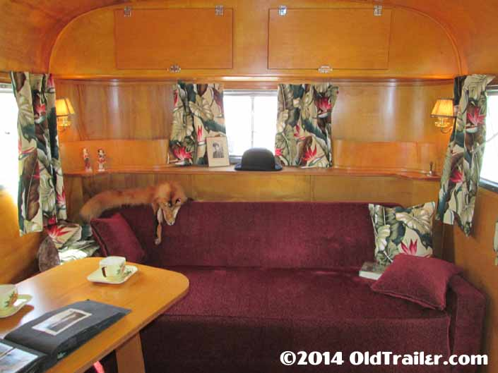 Restored cabinets in the front living room area of a 1948 Vagabond vintage trailer