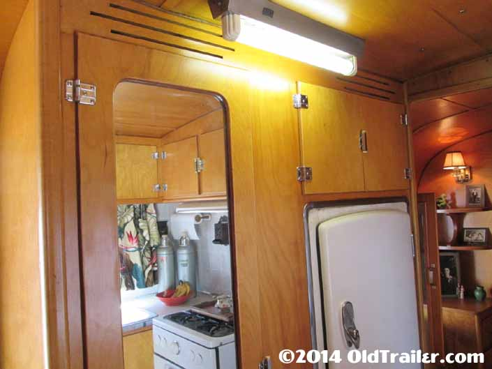 This vintage 1948 Vagabond trailer still has the original ceiling light fixture in the hallway