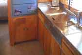 Photo of kitchen cabinets in a vintage 1948 Westcraft Sequoia Trailer