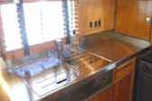 Picture of beautiful stainless steel counter top in 1948 Westcraft Sequoia Trailer