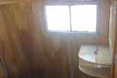 Photo of original wood paneling in un-restored 1948 Westcraft Westwood trailer