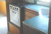 Photo of original blue formica kitchen countertop in 1948 Westcraft Westwood trailer
