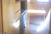Photo shows closet cabinetry and drawers in vintage 1948 Westcraft Westwood trailer