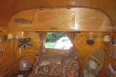 Photo of Adirondack hunting lodge accessories in vintage 1948 Westwood Coronado travel trailer living room