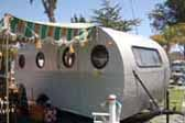 Skipper model 1949 vintage Airfloat travel trailer all setup for camping at Pismo Beach in California