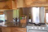 Very sharp kitchen cabinets and stainless steel countertops in 1949 Curtis Wright Trailer