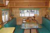 Photo shows woodwork and cabinets in vintage 1949 Star Trailer dining area