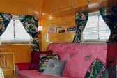 Photo shows the front ceiling cabinets in a vintage 1949 Vagabond trailer