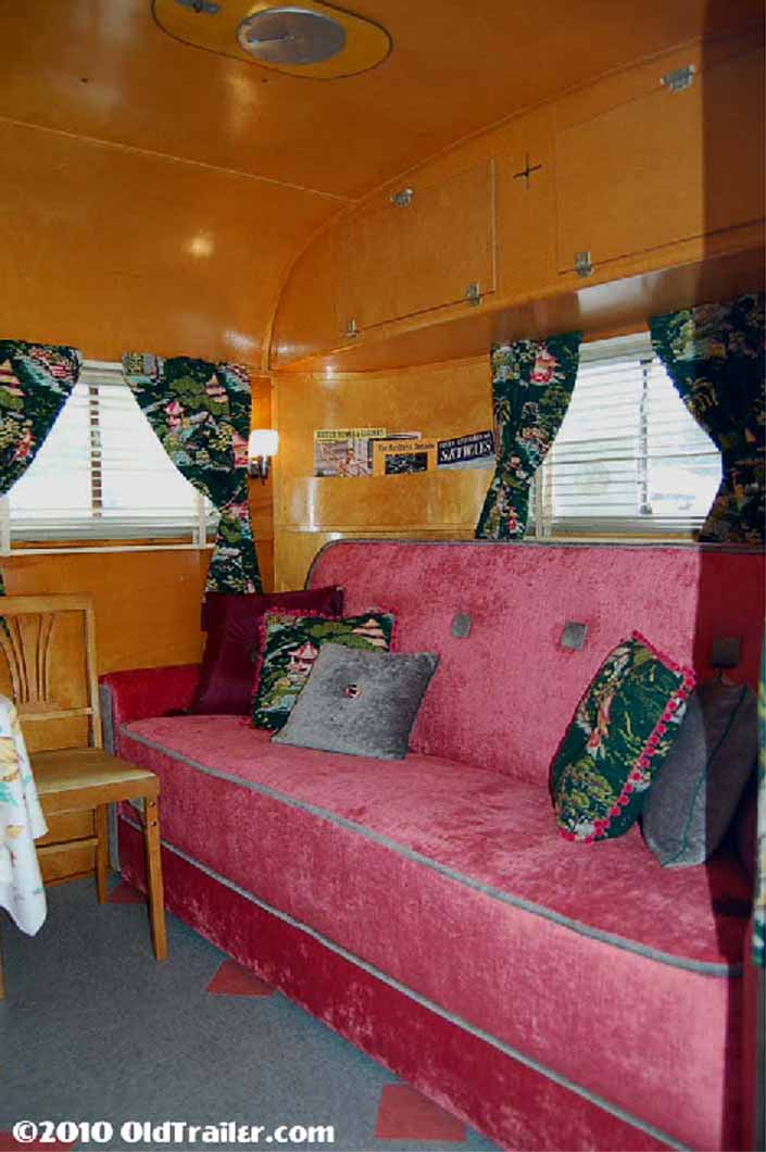 Living room ceiling cabinets in a vintage 1949 vagabond trailer