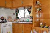 Beautifully restored kitchen area in a vintage 1949 Vagabond trailer
