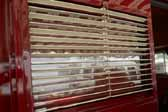 Picture of the iconic metal venetion blinds in a 1949 Vagabond trailer front door