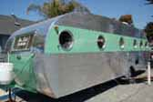 Beautifully restored 1950 vintage Airfloat Land Yacht trailer with polished corrugated aluminum siding