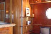 Beautifully re-finished wood cabinetry and paneling in a vintage 1950 Airfloat LandYacht trailert coach