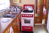 Fantastic Retro Kitchen and Red & White Vintage Gas Stove in 1950 Spartanette Tandem