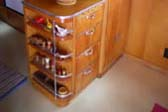 Warm and Golden Wood Cabinets in 1950 Spartanette Tandem Travel Trailer
