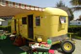 Restored 1950 Vagabond model 19 trailer camping at Pismo Vintage Trailer Rally