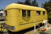 Picture of a 1950 Vagabond model-19 trailer painted lemon yellow