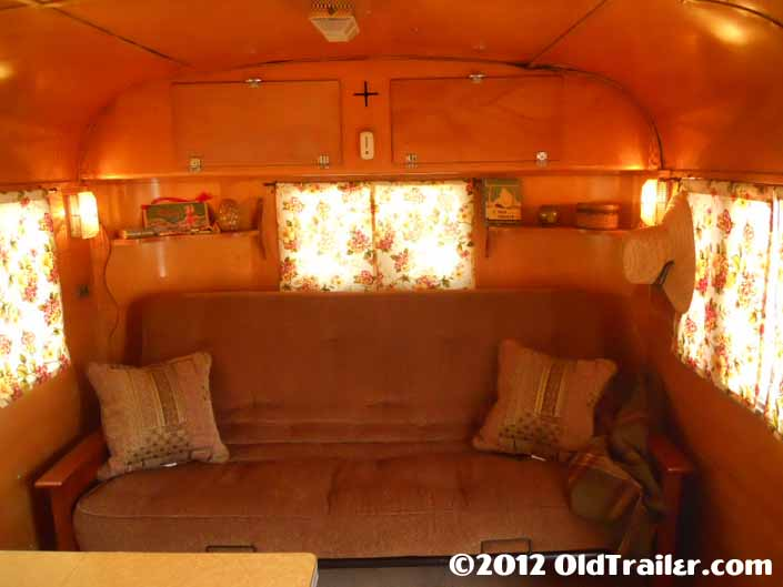 This restored 1950 Vagabond trailer has a warmly inviting living room