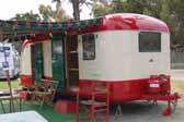 Photo of a restored 1950 vintage Vagabond trailer with dark green side awning
