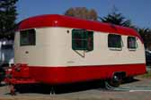 Dark green original window frames on a 1950 Vagabond trailer painted red and creme