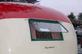 Photo shows the original hinge-up bedroom window in a restored 1950 Vagabond trailer