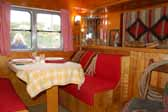 Great dining area on the street-side of a vintage 1950 Vagabond trailer