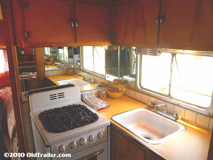 This 1950 vagabond trailer has bright yellow plastic laminate on the kitchen counter