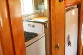 Photo shows the fridge and gas stove in a vintage 1950 Vagabond travel trailer