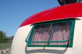 Photo shows beautifully restored rear window unit a vintage 1950 Vagabond trailer